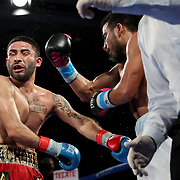 Ramon Cardenas (R) fights Angel Contreras during a One For All Promotions boxing event at the Caribe Royale Orlando Events Center on Saturday, February 20, 2021 in Orlando, Florida. (Alex Menendez via AP)