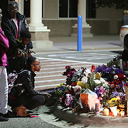 Residents are seen during a vigil to honor deceased Orlando Police officer Master Sgt. Debra Clayton who was shot and killed as she attempted to stop and question accused gunman Markeith Loyd, at an Orlando Walmart, on January 10, 2017 in Orlando, Florida. Orange County deputy Norm Lewis who was also killed on his motor patrol while responding to Clayton's shooting was also honored.  (Alex Menendez via AP)