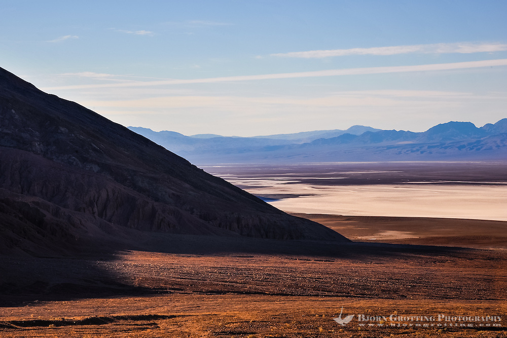 United States, California, Death Valley. View over Badwater Basin from Natural bridge road. Early in the morning,  the sun rises.