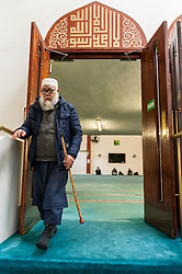 "© Licensed to London News Pictures. 07/02/2016. London, UK.  A worshipper exits the prayer room.  The East London Mosque & London Muslim Centre, in the heart of Tower Hamlets, and home to the UK's largest Muslim community, opens its doors as part of ""Visit My Mosque Day"", a national initiative facilitated by the Muslim Council of Britain, where mosques across the UK organise open days to allow the British public to see what goes on in a mosque and to understand its role in Muslim life.  The aims are ""to reduce the 'unknown' or 'fear' factor for members of the British public with their local mosque and Muslim communities"". Photo credit : Stephen Chung/LNP"
