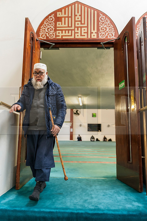 """© Licensed to London News Pictures. 07/02/2016. London, UK.  A worshipper exits the prayer room.  The East London Mosque & London Muslim Centre, in the heart of Tower Hamlets, and home to the UK's largest Muslim community, opens its doors as part of """"Visit My Mosque Day"""", a national initiative facilitated by the Muslim Council of Britain, where mosques across the UK organise open days to allow the British public to see what goes on in a mosque and to understand its role in Muslim life.  The aims are """"to reduce the 'unknown' or 'fear' factor for members of the British public with their local mosque and Muslim communities"""". Photo credit : Stephen Chung/LNP"""