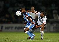 Photo: Rich Eaton.<br /> <br /> Hereford United v Wycombe Wanderers. Coca Cola League 2. 12/09/2006.Jermaine Easter left, who scored both Wycombes goals is held back by Hereford skipper Tamika Mkandawire