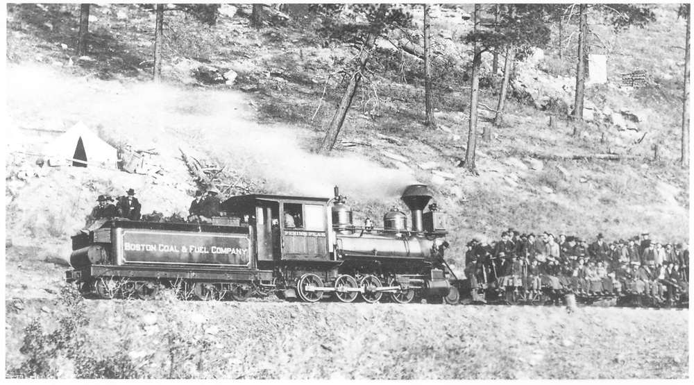 """Boston Coal and Fuel Co. Consolidation #1 with flat cars loaded with excursioners on the occasion of the coal mine railroad's opening day.<br /> Boston Coal & Fuel Co.  Perins Peak (later Calumet Branch), CO  Taken by Gonner, Frank - 11/25/1901<br /> In book """"RGS Story, The Vol. XI: Durango and the Perins Peak Branch"""" page 328<br /> Also in """"Narrow Gauge Country 1870-1970"""", p. 193; """"The Rio Grande Southern Story"""", p. 76 and p. 154; """"Colorado's Mountain Railroads"""", p. 29 and """"Rio Grande ? to the Pacific"""", p. 281.<br /> Thanks to Don Bergman for additional information."""