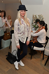 Actress SCARLETT BOWMAN at a Valentine's charity event to raise heart awareness and support the charity Arrhythmia Alliance held at Sophie Gass, 4 Ladbroke Grove, London on 13th February 2014.