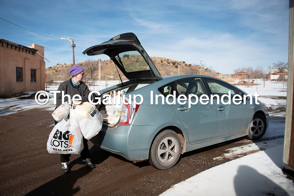 Susan Warren drops her recycling off at the Gallup Recycling Center Saturday, Jan. 4 in Gallup.