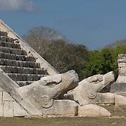Detail of snake heads at El Castillo temple in Chichen Itza. Yucatan, Mexico.