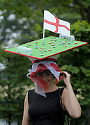 © Licensed to London News Pictures. 21/06/2012. Ascot, UK A woman wears a hat representing england V Ukraine in Euro 2012. Ladies Day at Royal Ascot 21st June 2012. Royal Ascot has established itself as a national institution and the centrepiece of the British social calendar as well as being a stage for the best racehorses in the world.. Photo credit : Stephen Simpson/LNP