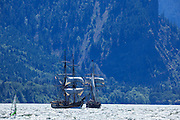 USA, Oregon, Hood River, windsurfers, and  Lady Washington and Hawaiian Chieftain of the Grays Harbor Historical Seaport Authority.