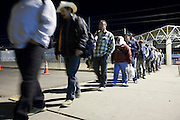 28 NOVEMBER 2006 - SAN LUIS, AZ: Farm workers stand in line to enter the US at the Port of Entry in San Luis, AZ, about 20 miles south of Yuma. Farmers and agricultural producers around Yuma, AZ, are facing a growing shortage of farm workers. Increased border enforcement have deterred many illegal workers from seeking work in Arizona and long lines at the ports of entry for legal workers are leading to the labor shortage. Some labor contractors are reporting as much as a 40 percent shortage of farm workers, Yuma farmers planted 15 percent fewer acres this year, compared to last, because of the shortage. More than 100,000 acres of iceberg lettuce are cultivated in Yuma county and more than 50,000 people are employed as seasonal farm workers at the height of the harvest, which is December through February. Nearly 3,500 seasonal farm workers stand in line for up to two hours every morning at the San Luis, AZ, Port of Entry to enter the US legally to work in the fields. Experienced workers can make as much as $14 (US) per hour during the harvest.  Photo by Jack Kurtz