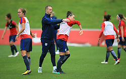 England Women manager Mark Sampson (left) gets into an altercation with Lucy Bronze during the training session at St George's Park, Burton.