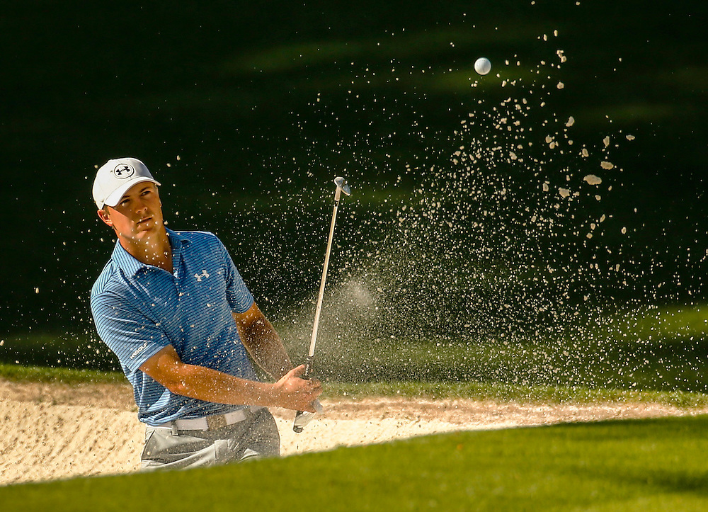 Jordan Spieth of the U.S. hits from a sand trap and onto the tenth green during third round play of the Masters golf tournament at the Augusta National Golf Course in Augusta, Georgia April 11, 2015.   REUTERS/Mark Blinch