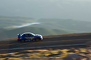 June 26-30 - Pikes Peak Colorado. Gregoire Blanchon runs his car during practice for the 91st running of the Pikes Peak Hill Climb.