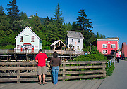 Alaska, Ketchikan. Walking tour of the historic Creek Street district built over water with a view towards more modern buildiings.