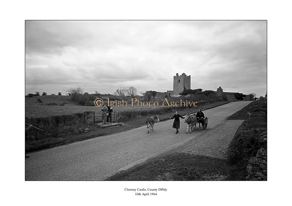Donkey and cart pictured near Clonony Castle, County Offaly.<br /> <br /> 10th April 1964<br /> <br /> 10.04.1964