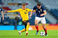 Thorgan Hazard (#16) of Belgium tackles John McGinn (#7) of Scotland during the International Friendly match between Scotland and Belgium at Hampden Park, Glasgow, United Kingdom on 7 September 2018.