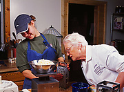 French chef Madeleine Kamman and Sara Spudowski weighing cheese for Blue Cheese Quiche, cooking seminar at Kirsten and Carl Dixon's Winterlake Lodge, Alaska.  (Model Released)