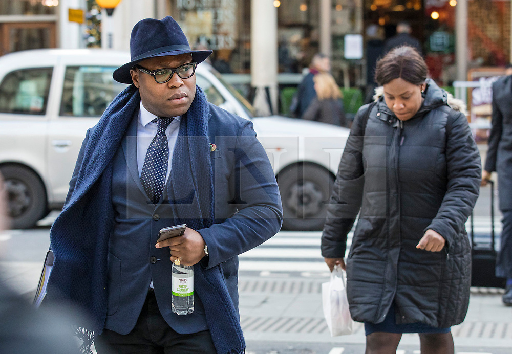 © Licensed to London News Pictures. 23/02/2018. London, UK. Lanre Haastrup (C), followed by his wife, Takesha Thomas (R), parents of 11-month-old Isaiah Haastrup, arrive at the High Court in London. Judges are set to rule on whether doctors at King's College Hospital can withdraw life support for Isaiah who suffered severe brain damage. Photo credit: Rob Pinney/LNP