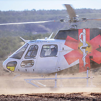 030915       Adron Gardner<br /> <br /> A Gallup Med Flight helicopter p reapers for lift off carrying an elderly couple in Fort WIngate Monday.  Emergency responders rescued the couple after they spend the night stuck in the mud near McGaffey.