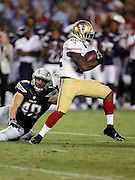 San Francisco 49ers running back Mike Davis (22) runs the ball for a short gain while being chased by San Diego Chargers linebacker Nick Dzubnar (48) in the third quarter during the 2016 NFL preseason football game against the San Diego Chargers on Thursday, Sept. 1, 2016 in San Diego. The 49ers won the game 31-21. (©Paul Anthony Spinelli)