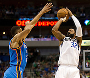 O.J. Mayo (32) of the Dallas Mavericks shoots the ball against the Oklahoma City Thunder at the American Airlines Center in Dallas on Sunday, March 17, 2013. (Cooper Neill/The Dallas Morning News)