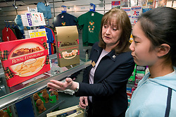 Young girl shopping for a present in a gift shop,