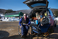 Bob and Christina Prew bring a picnic lunch to eat from the back of their car after a morning of skiing at Gunstock on Friday.   (Karen Bobotas Photo/for The Laconia Daily Sun)