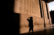 MENIN GATE, YPRES, BELGIUM. OVER 54,000 NAMES OF SOLDIERS WHO HAVE NO KNOWN FINAL RESTING PLACE ARE ENGRAVED ON THE WALLS OF THE MEMORIAL. EUROPE. THE PHOTOGRAPHERS SON, JACOB, 6, PHOTOGRAPHS THE MENIN GATE INSCRIPTIONS.  THE WW1-1914-1918 CEMETERIES AND MEMORIALS MAINTAINED BY THE COMMONWEALTH WAR GRAVES COMMISSION..COPYRIGHT PHOTOGRAPH BY BRIAN HARRIS  © 2006.0044(0)7808-579804-brianharrisphoto@ntlworld.com OR brian@brianharrisphotographer.co.uk