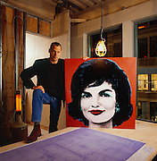 Perry Rubenstein with Warhol painting of Jackie O.