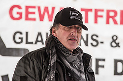 February 5, 2018 - Munich, Bavaria, Germany - Heinz Meyer, the former head of Pegida Muenchen (Pegida München) defiantly wearing a Glock guns hat.  Meyer has been under terrorism monitoring by the Generalbundesanwalt (Federal Prosecutor) since 2012 and was the target of anti-weapons raids in April of 2017.  Meyer has numerous active processes (Credit Image: © Sachelle Babbar via ZUMA Wire)