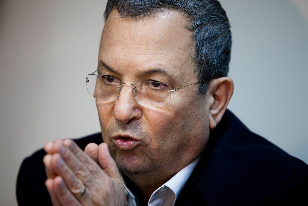 Israel's Defense Minister Ehud Barak gestures as he speaks during an Atzmaut faction meeting at the Knesset, Israel's parliament in Jerusalem, on January 30, 2012.