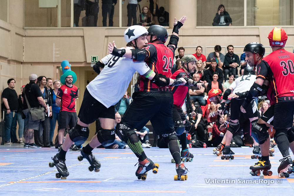 Player #24 Perez of Team Spain trying to block Team Belgium jammer at MRDWC2018 in Barcelona, Spain.