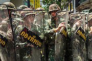 25 MAY 2014 - BANGKOK, THAILAND:  Thai soldiers form a line as anti-military protestors closed in around them. Public opposition to the military coup in Thailand grew Sunday with thousands of protestors gathering at locations throughout Bangkok to call for a return of civilian rule and end to the military junta.    PHOTO BY JACK KURTZ