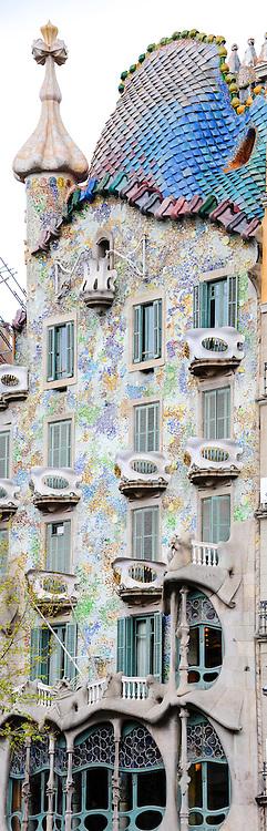 Spain, Barcelona. Casa Batlló is one of Antoni Gaudí's masterpieces. Panorama of exterior.