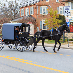 Intercourse, PA - December 1, 2014: An Amish buggy drives on the Old Philadelphia Pike, the main street of the Lancaster County village.