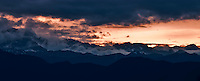 Clouds over Olympic Mountain ridges clear at sunset - Olympic National Forest and Park, viewed from the Hood Canal of Puget Sound, Washington, USA panorama