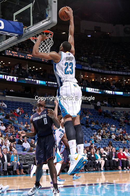 October 9, 2012; New Orleans, LA, USA; New Orleans Hornets forward Anthony Davis (23) dunks over Charlotte Bobcats forward Bismack Biyombo (0) during the third quarter of a preseason game at the New Orleans Arena. The Hornets defeated the Bobcats 97-82.  Mandatory Credit: Derick E. Hingle-US PRESSWIRE