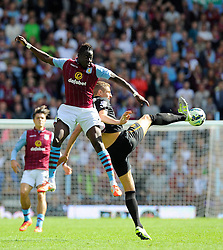 Aston Villa's Aly Cissokho battles for the high ball with Hull City's Michael Dawson - Photo mandatory by-line: Joe Meredith/JMP - Mobile: 07966 386802 31/08/2014 - SPORT - FOOTBALL - Birmingham - Villa Park - Aston Villa v Hull City - Barclays Premier League