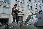 Moscow, Russia, August 1991..Pro-Yeltsin soldiers with a portrait of Russian Federation President Boris Yeltsin on their armoured personnel carrier. Pro-democracy demonstrators supporting Russian President Boris Yeltin take to the streets to defy tanks and soldiers sent by hard-line Communists, who imprisoned Soviet President Mikhail Gorbachev in an attempted coup which collapsed after 3 days...