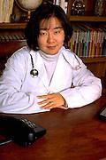 Korean physician doctor age 29 working at desk.  St Paul Minnesota USA