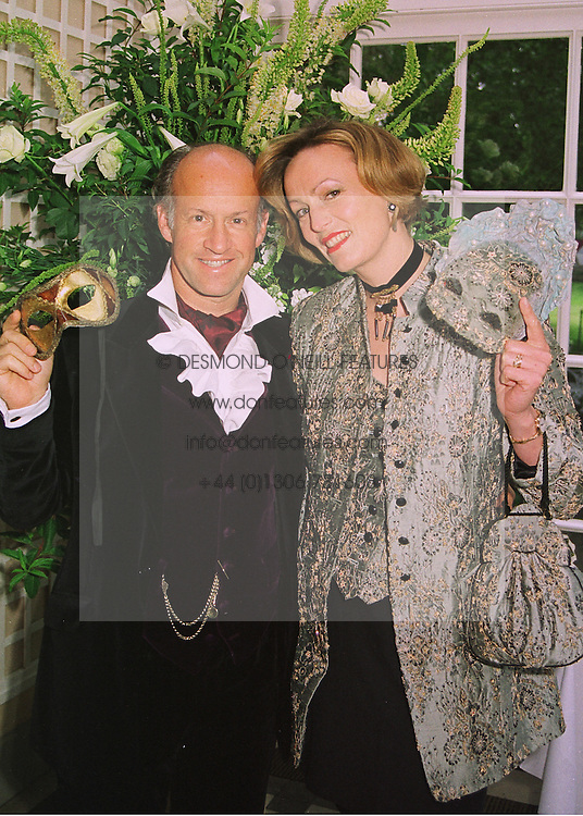 MR & MRS ROGER SAUL he is head of the fashion house Mulberry, at a ball in London on 18th June 1998.MIO 5