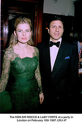 The HON.SIR ROCCO & LADY FORTE at a party in London on February 10th 1997.LWJ 47