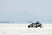 Best cars-people-atmosphere-photos of 2009 Bonneville Speed Week- S&E Racing's 1929 Ford Roadster, owned and driven by Al Eshenbaugh of Phoenix AZ. makes a run at the Bonneville Speed Way. August 9, 2009.  Photo by Colin E. Braley