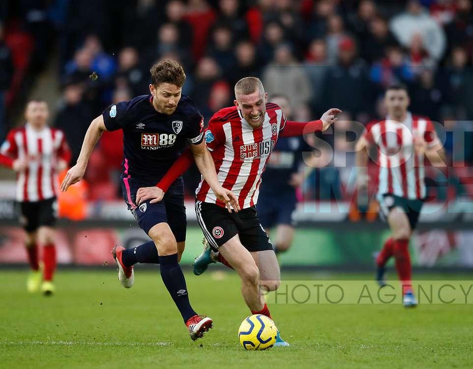 Oli McBurnie of Sheffield Utd tacked by Simon Francis of Bournemouth during the Premier League match at Bramall Lane, Sheffield. Picture date: 9th February 2020. Picture credit should read: Simon Bellis/Sportimage
