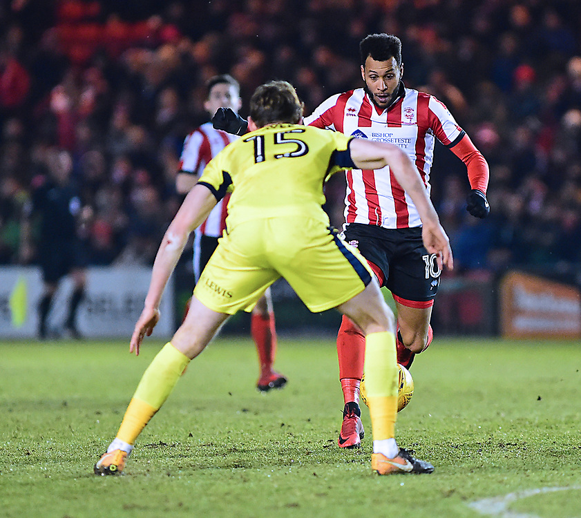 Lincoln City's Matt Green vies for possession with Cheltenham Town's William Boyle<br /> <br /> Photographer Andrew Vaughan/CameraSport<br /> <br /> The EFL Sky Bet League Two - Lincoln City v Cheltenham Town - Tuesday 13th February 2018 - Sincil Bank - Lincoln<br /> <br /> World Copyright © 2018 CameraSport. All rights reserved. 43 Linden Ave. Countesthorpe. Leicester. England. LE8 5PG - Tel: +44 (0) 116 277 4147 - admin@camerasport.com - www.camerasport.com
