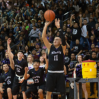 Miyamura Patriots small forward Noah Nells (11) takes three point shot tying the game 36-36 in the third quarter during the 4A -District Tournament Championship game at Gallup High School Saturday.
