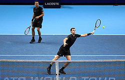 Jamie Murray (right) and Bruno Soares in action during day four of the NITTO ATP World Tour Finals at the O2 Arena, London.