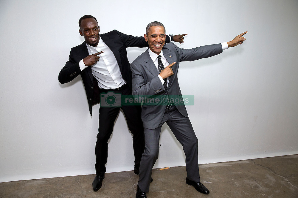 """President Barack Obama poses with Usain Bolt, the fastest runner in the world, backstage following a """"Young Leaders of the Americas Initiative"""" town hall at the University of the West Indies in Kingston, Jamaica, April 9, 2015.  (Official White House Photo by Pete Souza)<br /> <br /> This official White House photograph is being made available only for publication by news organizations and/or for personal use printing by the subject(s) of the photograph. The photograph may not be manipulated in any way and may not be used in commercial or political materials, advertisements, emails, products, promotions that in any way suggests approval or endorsement of the President, the First Family, or the White House."""