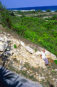 Captain Keith Tibbetts sitting on the Bluff on south side, Cayman Brac, Cayman Islands, West Indies c 1990