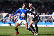 Chesterfield forward Jacob Brown (44) holds off Notts County midfielder Jorge Grant (10) during the EFL Sky Bet League 2 match between Chesterfield and Notts County at the b2net stadium, Chesterfield, England on 25 March 2018. Picture by Jon Hobley.
