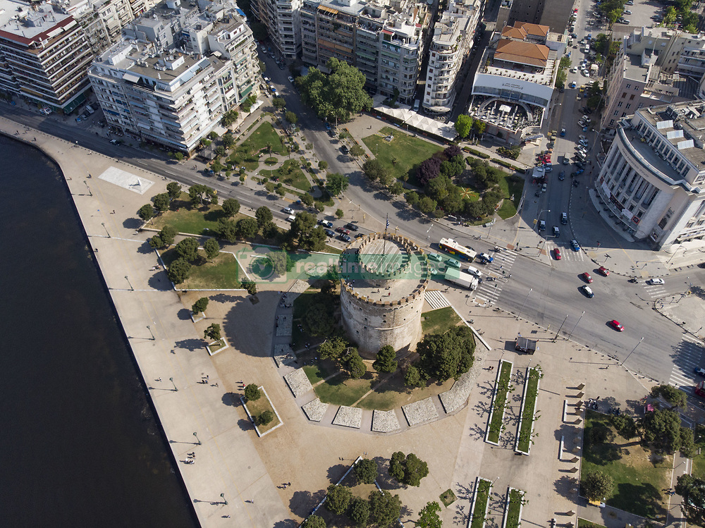 April 25, 2018 - Thessaloniki, Greece - Aerial images made by a drone of Thessaloniki's monument and symbol, the White Tower in Thessaloniki, Greece, on 25 April, 2018. The tower is located on the waterfront in Thessaloniki, it works as a museum with the city's history as well with some temporary exhibitions. The tower was built in this shape in the 15th century as a part of a fortress. (Credit Image: © Nicolas Economou/NurPhoto via ZUMA Press)